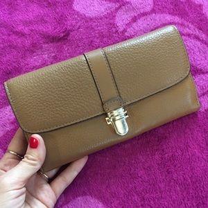 Genuine leather Michael Kors wallet.
